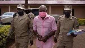 Paul Rusesabagina in cuffs. (BBC)